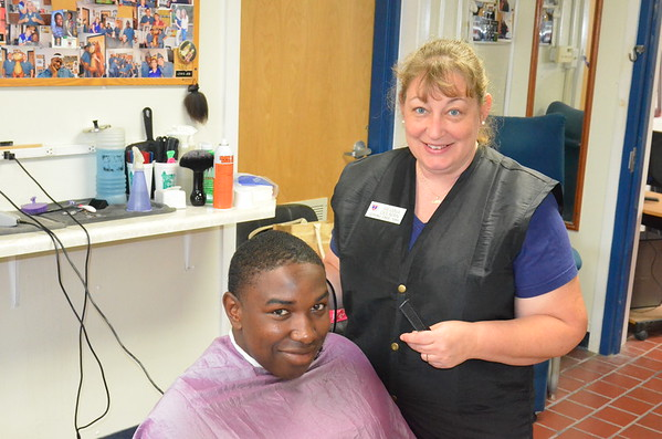 Cadets get fresh haircuts from barber