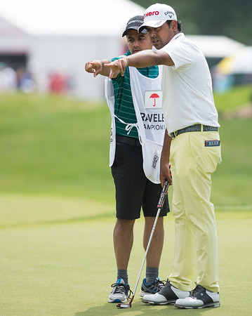 06/24/18 Wesley Bunnell   Staff The final day of The Travelers Championship at TPC River Highlands in Cromwell on Sunday June 24. Anirban Lahiri points out the breaks on the green with his caddie. Lahiri finished T9 with a -12 on the tournament.
