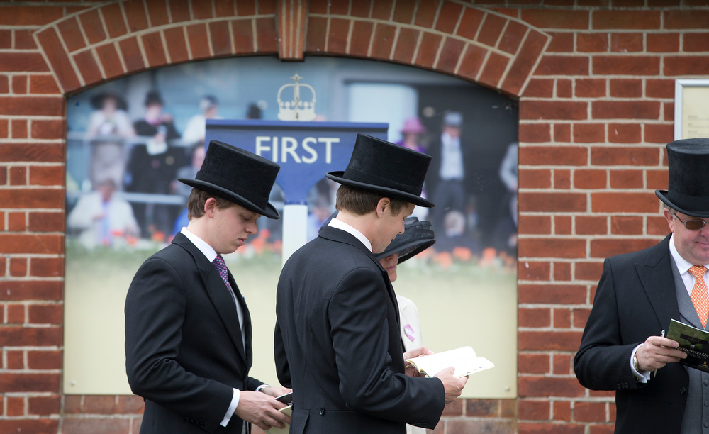 . Racegoers queue for entry to the royal enclosure on the third day traditionally known as Ladies Day of the Royal Ascot horse race meeting in Ascot, England, Thursday, June 20, 2013. (AP Photo/Alastair Grant)