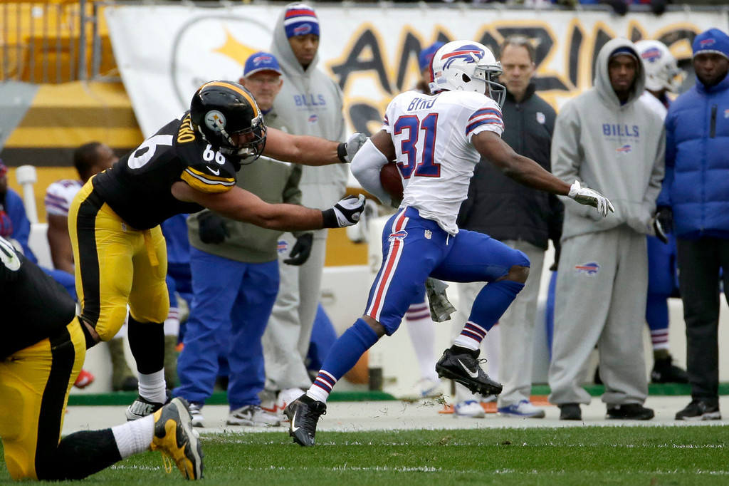 . Buffalo Bills\' Jairus Byrd, right, returns an interception as Pittsburgh Steelers guard David DeCastro (66) reaches for him during the first half of an NFL football game on Sunday, Nov. 10, 2013, in Pittsburgh. (AP Photo/Gene J. Puskar)