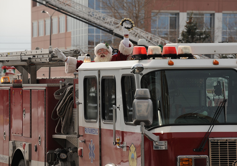 . Season to Share Santa Claus arrives on an Aurora Fire Department engine. The Children\'s Hospital\'s 26th annual Toy Run brought together hundreds of motorcycle enthusiasts to bring thousands of toys for sick children at the hospital today, Sunday December 4th, 2011. The toy run is a long-standing Children\'s tradition where motorcyclists travel together to the hospital, delivering armfuls of toys to brighten patient\'s spirits for the holiday season.  The ride starts in Aurora at the Aurora Sports Park and travels to Children\'s where armfuls of toys are donated to the sick children.   Helen H. Richardson, The Denver Post