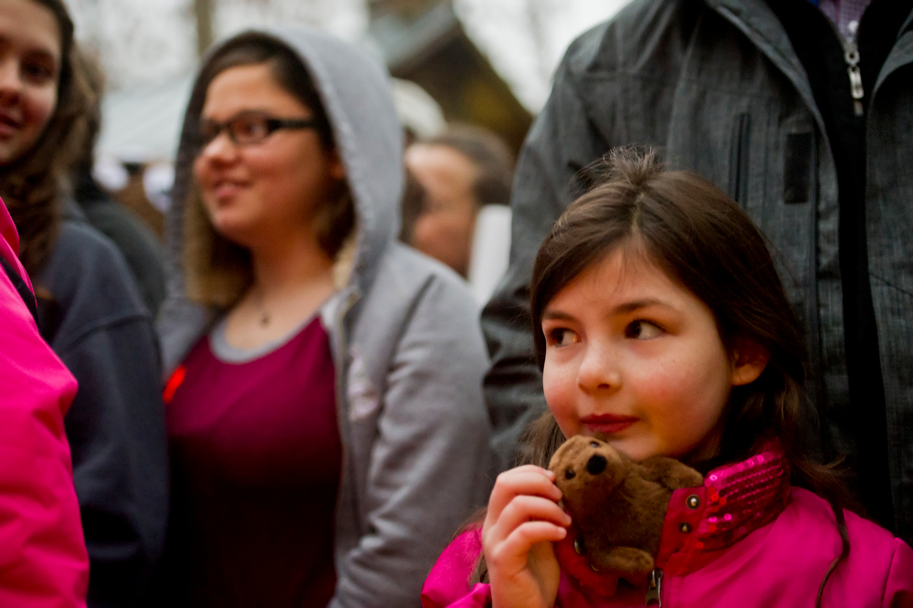 . Reagan Dailey, right, holds her groundhog stuffed animal as she and a few hundred people wait for General Beauregard Lee to appear at the Yellow River Game Ranch in Lilburn, Ga., Sunday, Feb. 2, 2014.The famous groundhog, according to officials, did not see his shadow this year heralding in an early spring. Beau has had a 93% success rate in the past for correctly predicting the coming next few weeks. (AP Photo/Atlanta Journal-Constitution, Jonathan Phillips)