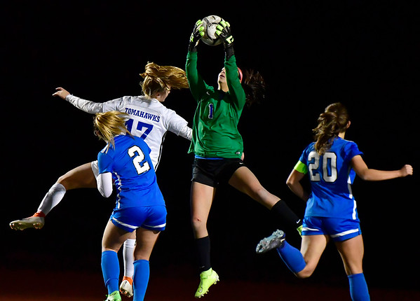 11/23/2019 Mike Orazzi | Staff Southington High School's Emily Eigo (1) makes a save during the Class LL Girls State Soccer Tournament at Veterans Stadium in New Britain Saturday evening. Glastonbury won 1-0.