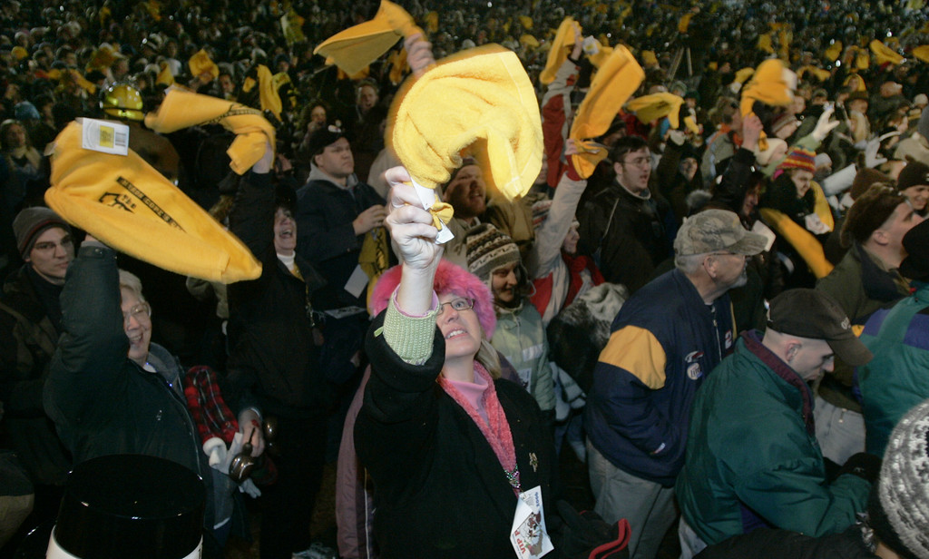 ". A portion of the crowd wave ""Terrible Towels\"" while waiting for the prediction of six more weeks of winter was announced at Grounghog Day festivities in Punxsutawney, Pa. on Thursday, Feb. 2, 2006. The towel is used by Pittsburgh Steelers fans to show support for their team who are playing in the Super Bowl on Sunday, Feb. 5. (AP Photo/Keith Srakocic)"
