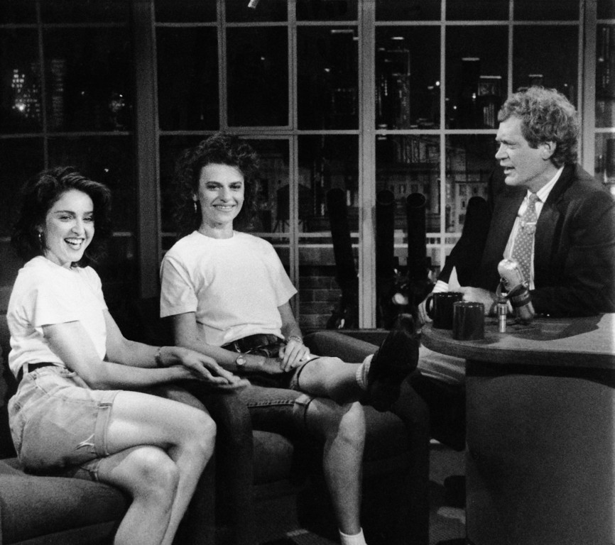 """. Superstar singer and now stage actress Madonna joined host David Letterman and comedian Sandra Bernhard for the taping of \""""Late Night with David Letterman\"""" in NBC Studios on Friday, July 1, 1988 in New York. Madonna\'s first appearance on the show was a surprise addition to the celebration of the series\' 1,000th taping. (AP Photo/NBC)"""