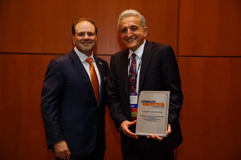 Thomas Roberts, Jr., MD, Chair of the Conquer Cancer Foundation, presenting the Clinical Trials Participation Awards to Virginia Cancer Specialists Research Institute represented by Alex Spira, MD, PhD, FACP, during Clinical Trials Participation Awards