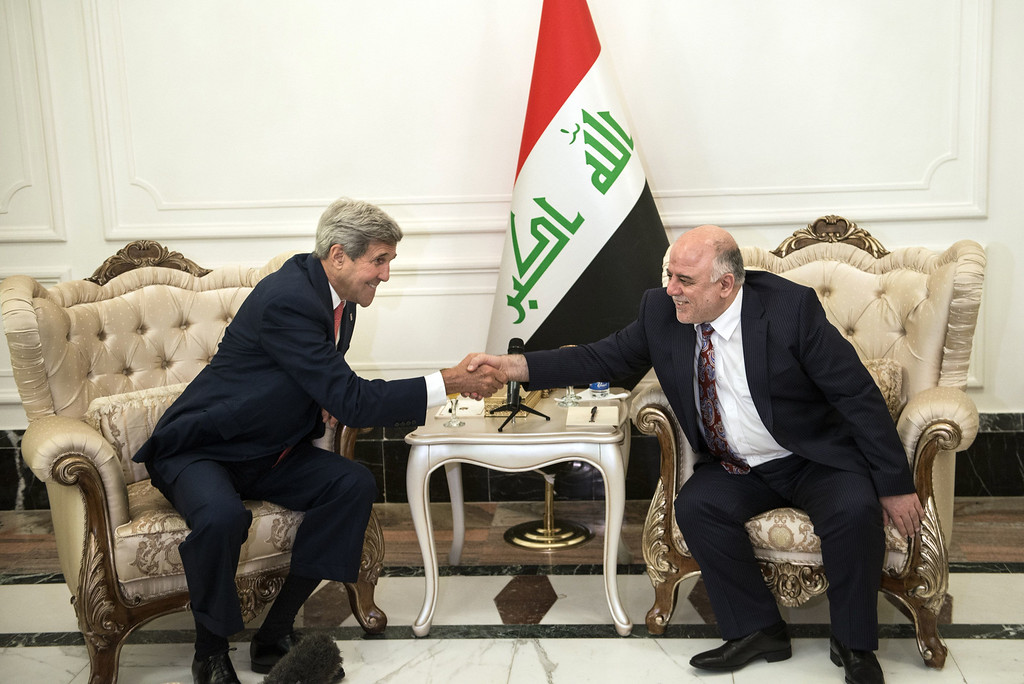 . US Secretary of State John Kerry (L) and new Iraqi Prime Minister Haider al-Abadi (R) shake hands after a meeting on September 10, 2014 in Baghdad. Kerry flew into Iraq today for talks with its new leaders on their role in a long-awaited new strategy against Islamic State jihadists to be unveiled by President Barack Obama. AFP PHOTO/POOL/BRENDAN SMIALOWSKIBRENDAN SMIALOWSKI/AFP/Getty Images