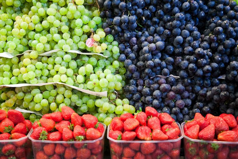 Grapes and strawberries, Boqueria market, town of Barcelona, autonomous commnunity of Catalonia, northeastern Spain