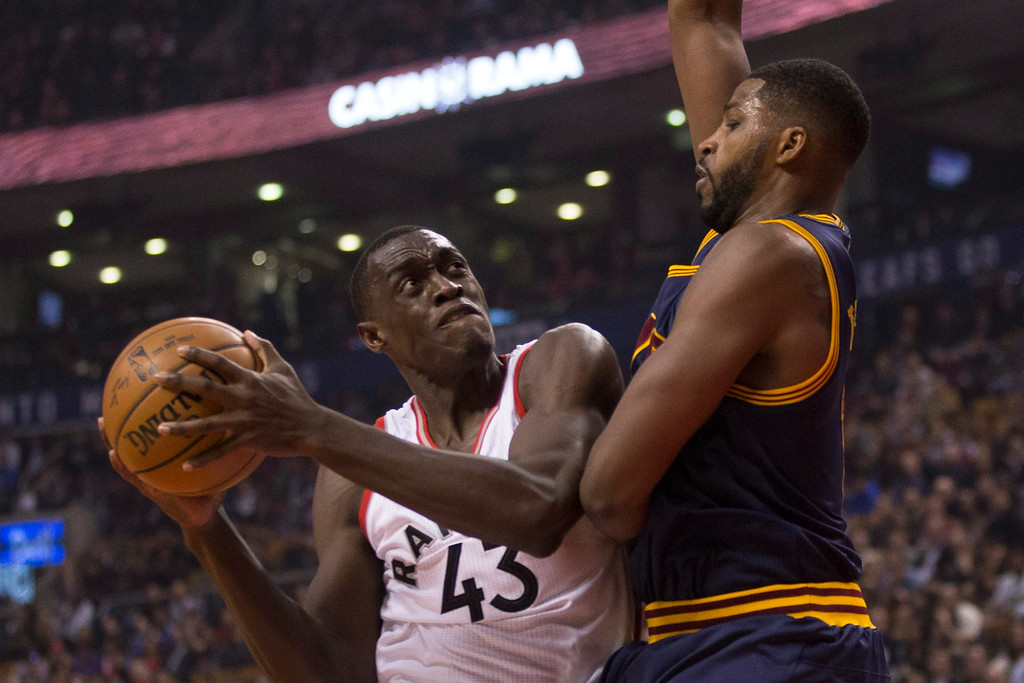 . Toronto Raptors forward Pascal Siakam drives against Cleveland Cavaliers forward Tristan Thompson during the first half of an NBA basketball game in Toronto on Friday, Oct. 28, 2016. (Chris Young/The Canadian Press via AP)