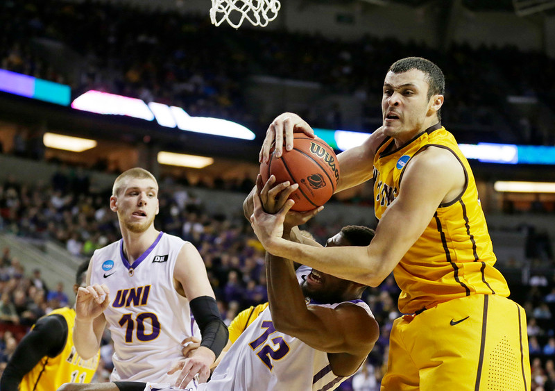 . Wyoming\'s Larry Nance Jr., right, and Northern Iowa\'s Marvin Singleton (12) battle for a rebound during the first half of an NCAA tournament college basketball game in the Round of 64 in Seattle, Friday, March 20, 2015. (AP Photo/Ted S. Warren)