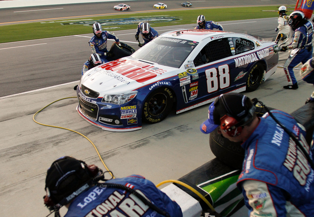 . Dale Earnhardt Jr. makes a pit stop for fuel and tires during the NASCAR Sprint Cup auto race at Daytona International Speedway, Saturday, July 6, 2013, in Daytona Beach, Fla. (AP Photo/Reinhold Matay)
