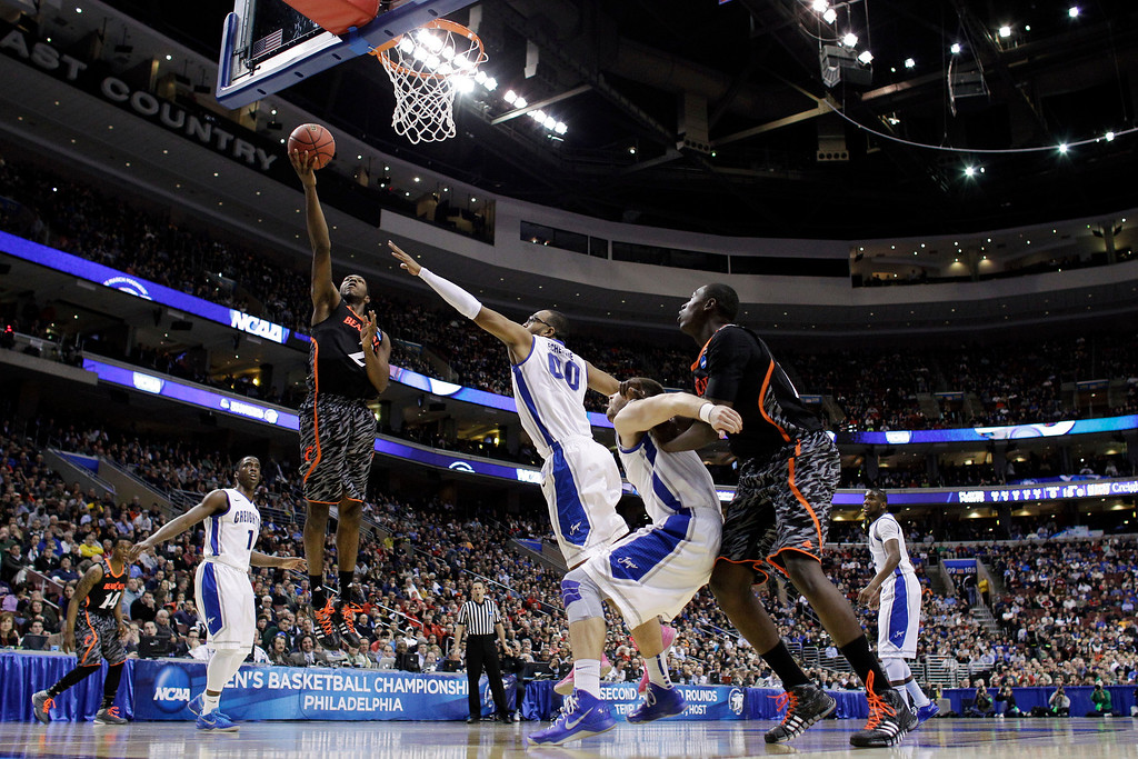 . Cincinnati\'s Titus Rubles (2) goes up for a shot as Creighton\'s Gregory Echenique (00) defends during the first half of a second-round game of the NCAA college basketball tournament, Friday, March 22, 2013, in Philadelphia. (AP Photo/Matt Slocum)