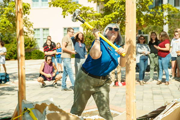 Students take hammers to the replica of the Berlin Hall in Koski Plaza Friday, Nov. 8.