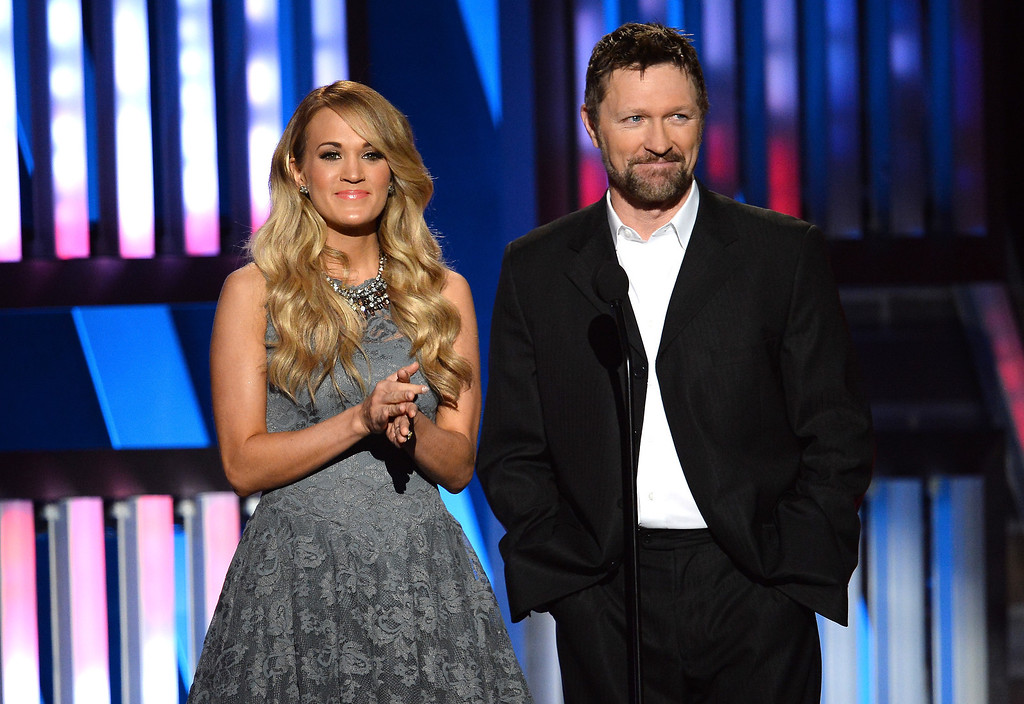 . Singers Carrie Underwood (L) and Craig Morgan speak onstage during ACM Presents: An All-Star Salute To The Troops at the MGM Grand Garden Arena on April 7, 2014 in Las Vegas, Nevada.  (Photo by Ethan Miller/Getty Images for ACM)