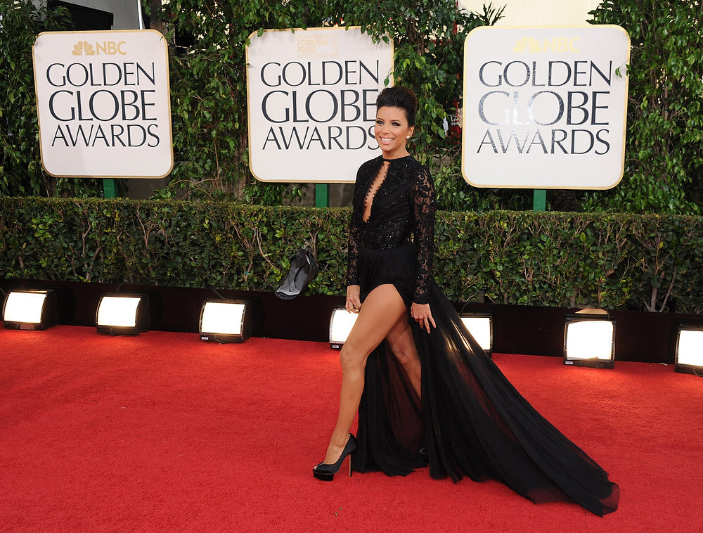 Description of . Actress Eva Longoria arrives at the 70th Annual Golden Globe Awards at the Beverly Hilton Hotel on Sunday Jan. 13, 2013, in Beverly Hills, Calif. (Photo by Jordan Strauss/Invision/AP)