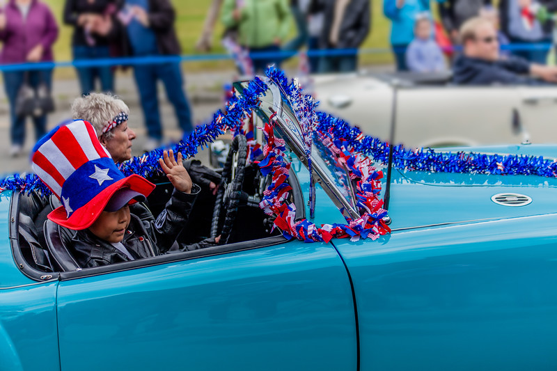 Women in car in fourth of July parade
