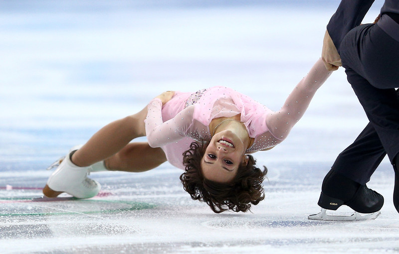 . Meagan Duhamel and Eric Radford of Canada compete in the Figure Skating Pairs Short Program during the Sochi 2014 Winter Olympics at Iceberg Skating Palace on February 6, 2014 in Sochi, Russia.  (Photo by Clive Mason/Getty Images)
