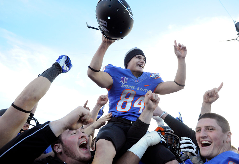 Description of . Boise State kicker Michael Frisina (84) celebrates after his team defeated Washington at the MAACO Bowl NCAA college football game on Saturday, Dec. 22, 2012, in Las Vegas. Frisina kicked the go-ahead field goal in the fourth quarter for a 28-26 final. (AP Photo/David Becker)
