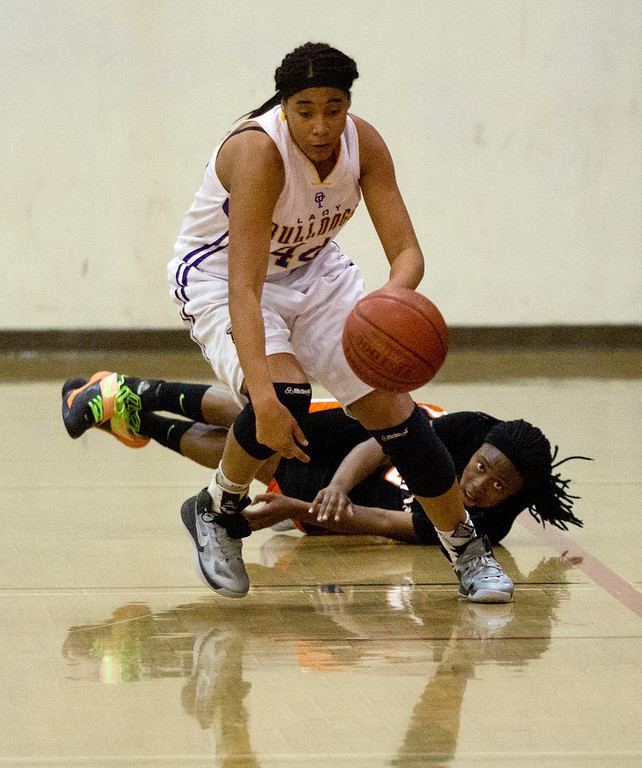 . Oakland Technical High School\'s Kelea Pickeral-Dennis (44) fouls McClymonds High School\'s Ahjahna Coleman while pursuing a loose ball during the fourth quarter of their Oakland Athletic League girls\' basketball game, Wednesday, Feb. 20, 2013 in Oakland, Calif. McClymonds won, 62-50. (D. Ross Cameron/Staff)