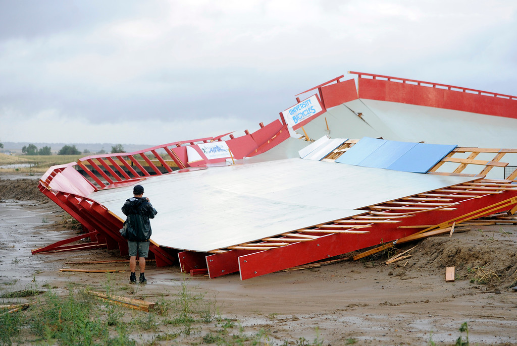 . Mikel Reid, construction foreman for the Erie Velodrome, looks over the damage to the track from the high winds and rain  that moved  through  Erie, Colorado on August 3, 2013. For more photos and videos of the storm damage, go to www.dailycamera.com. Cliff Grassmick  / August 3, 2013
