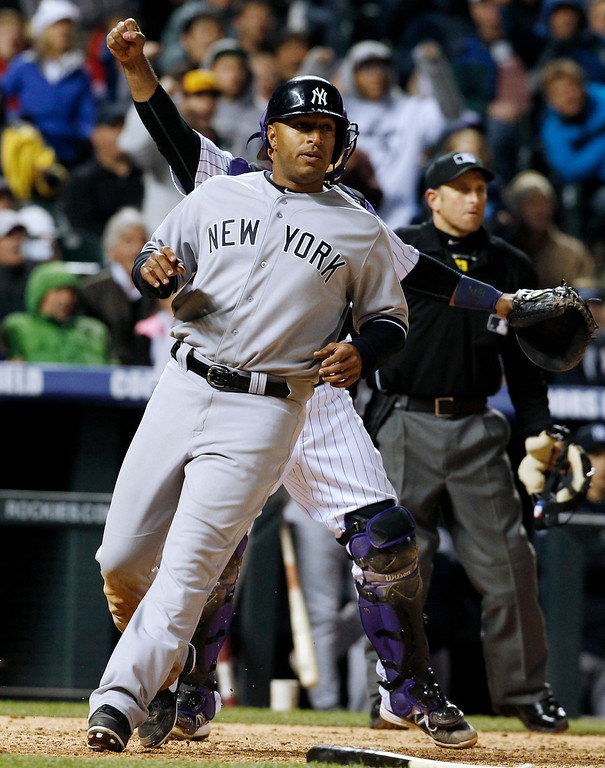. New York Yankees\' Vernon Wells crosses home plate to score the go-ahead run on an infield single by pinch-hitter Brennan Boesch in the ninth inning of a baseball game against the Colorado Rockies in Denver on Wednesday, May 8, 2013.  The Yankees won 3-2. (AP Photo/David Zalubowski)