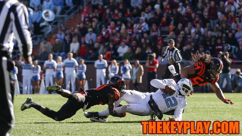 UNC quarterback Marquise Williams (12) gets tackled by Brandon Facyson (31). (Mark Umansky/TheKeyPlay.com)