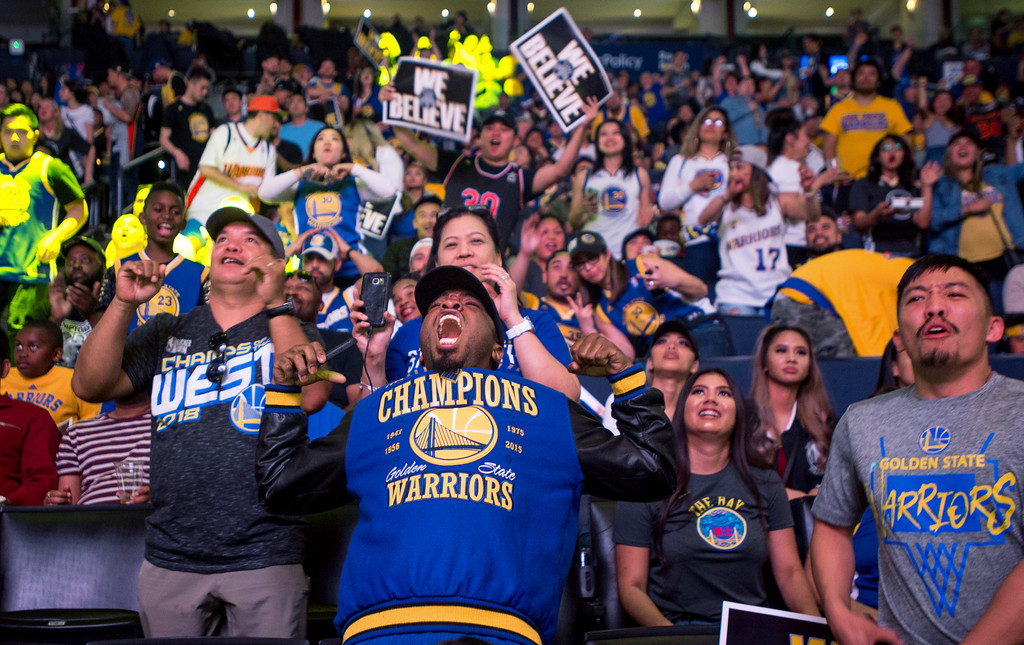 . Fans react while watching the broadcast of the Golden State Warriors playing the Cleveland Cavaliers in Game 4 of the NBA Finals, at Oracle Arena in Oakland, Calif., Friday, June 8, 2018. (AP Photo/Josh Edelson)