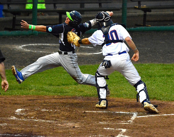 6/27/2018 Mike Orazzi | Staff Bristol Blues' Patrick Winkel (30) tags out out the Worcester Bravehearts' Joseph Pesce (18) at Muzzy Field Wednesday night.