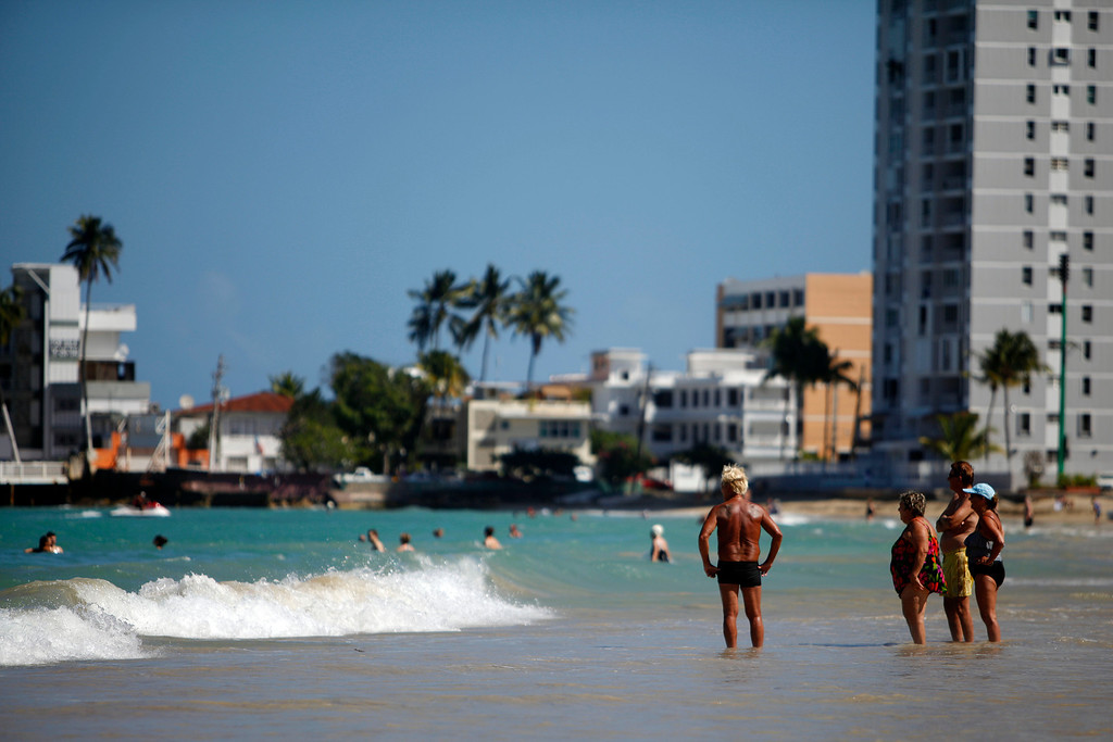 . People enjoy a sunny day at the Isla Verde Beach, in Carolina, Puerto Rico, Jan. 24, 2013. A good tip for all Puerto Rican beaches is to go early in the morning when the water is calm and there are no crowds. Otherwise, go to Vieques, which has spectacular beaches and that are secluded even in the high season. (AP Photo/Ricardo Arduengo)