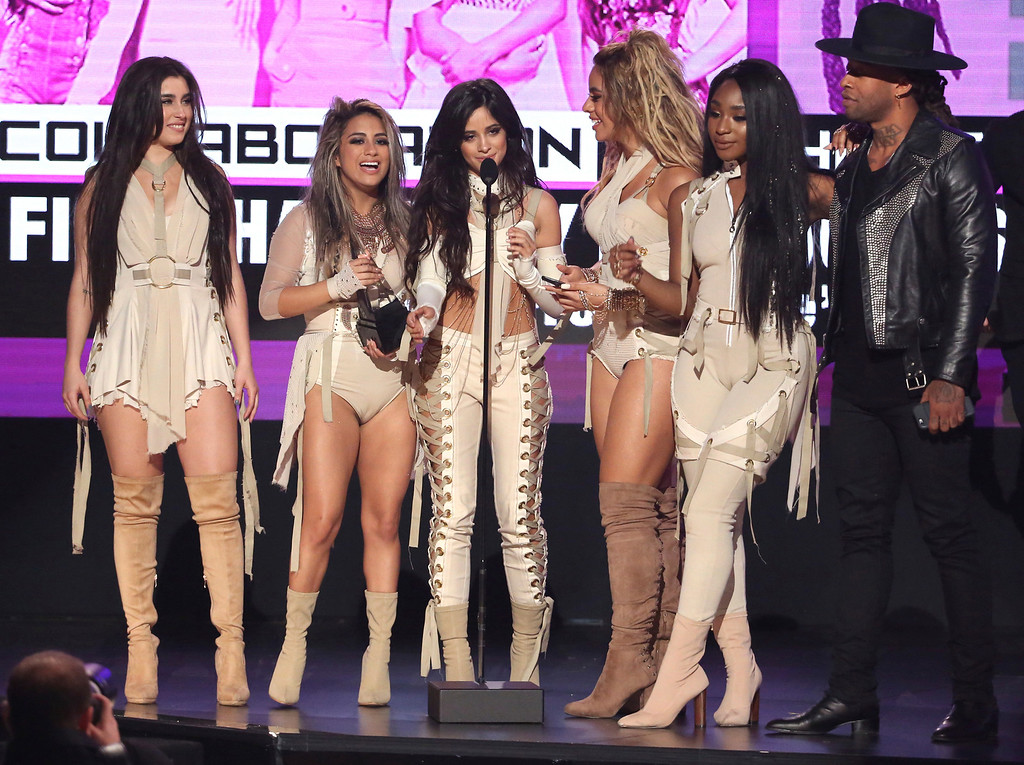 ". Lauren Jauregui, from left, Ally Brooke, Camila Cabello, Dinah Jane, Normani Kordei, of Fifth Harmony, and Ty Dolla $ign accept the award for collaboration of the year for ""Work From Home\"" at the American Music Awards at the Microsoft Theater on Sunday, Nov. 20, 2016, in Los Angeles. (Photo by Matt Sayles/Invision/AP)"