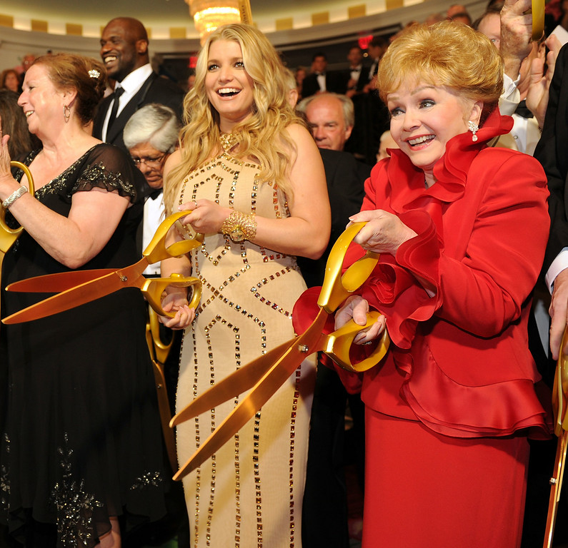. Jessica Simpson and Debbie Reynolds participate in the ribbon cutting at the grand opening of the Casino Club at The Greenbrier on July 2, 2010 in White Sulphur Springs, West Virginia.  (Photo by Bryan Bedder/Getty Images)