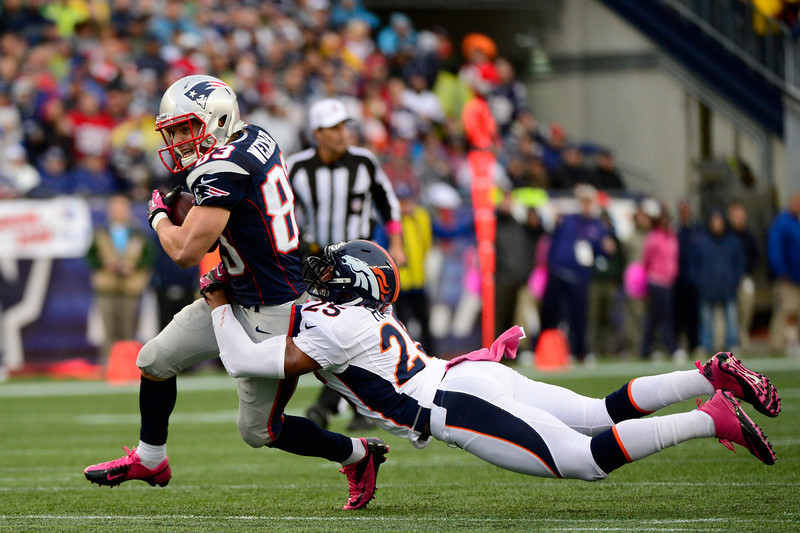 . New England Patriots wide receiver Wes Welker #83 trying to break from Denver Broncos strong safety Chris Harris #25 in the first half in Gillette Stadium, Foxbrough Massachusetts, Sunday, October 7th, 2012.      Joe Amon, The Denver Post