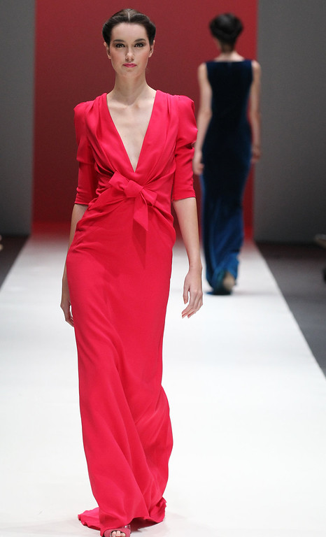 . Models showcase outfits by New York based designer Carolina Herrera for \'The House of Herrera\'  Fall 2013 collection, in Singapore, Wednesday, May 15, 2013,  during the annual Fashion Festival held in the city-state. (AP Photo/Wong Maye-E)