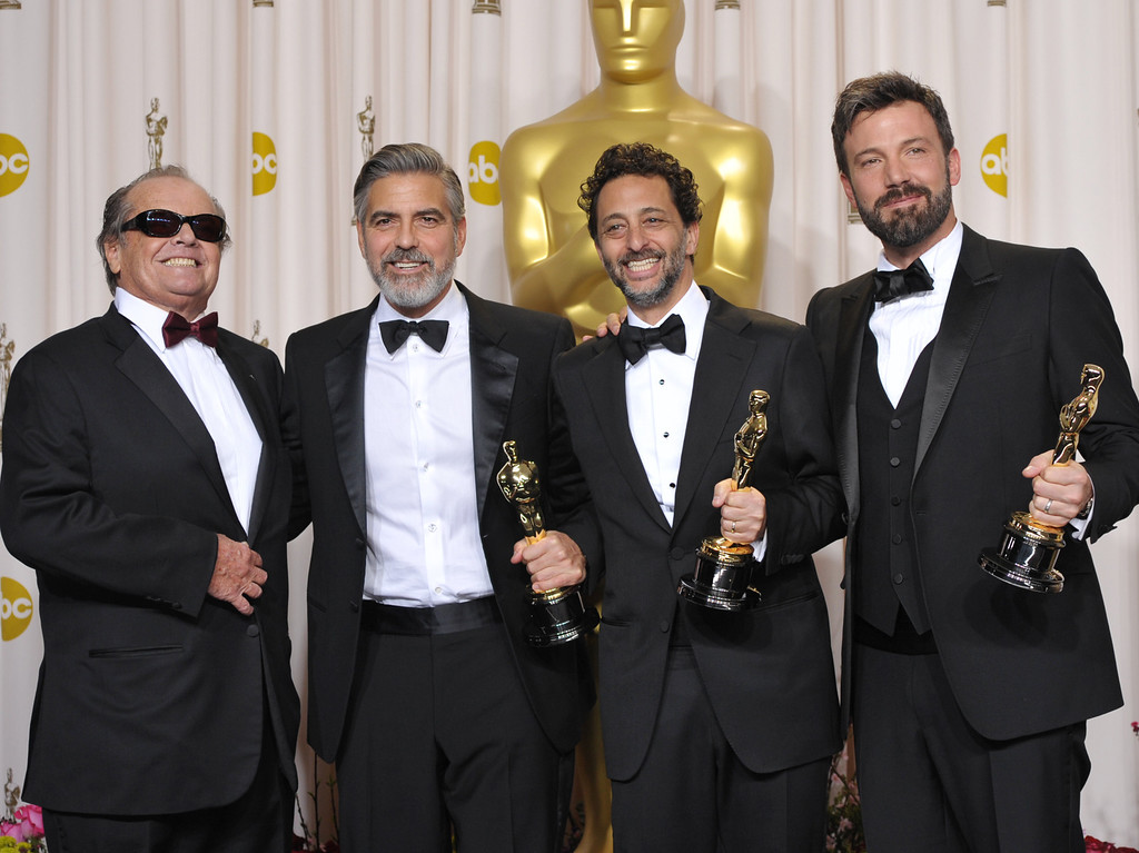 ". From second left, George Clooney, Grant Heslov, and Ben Affleck poses with their awards for best picture for ""Argo\"" with presenter Jack Nicholson during at the Oscars at the Dolby Theatre on Sunday Feb. 24, 2013, in Los Angeles. (Photo by John Shearer/Invision/AP)"