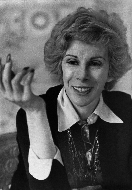 """. Comedienne Joan Rivers gestures during an interview, April 1979. She has concluded a contract with Columbia Pictures to direct and star in a comedy film, \""""A Girl Named Banana.\"""" Unlike her experience with her first film, this time she doesn\'t have to mortgage her house to raise money for the production. (AP Photo)"""