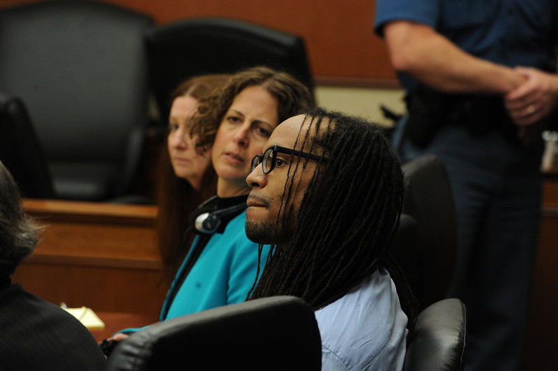 . Nathan Dunlap, siting next to one of his lawyers  Madeline Cohen, in blue, listens to the proceedings.  A hearing was held today to set a date for the execution of convicted murderer Nathan Dunlap at the Arapahoe County Court in Division court room 408  in Centennial, CO on May 1, 2013.   Judge William Sylvester is the presiding judge on the case.  (Photo by Helen H. Richardson/The Denver Post)