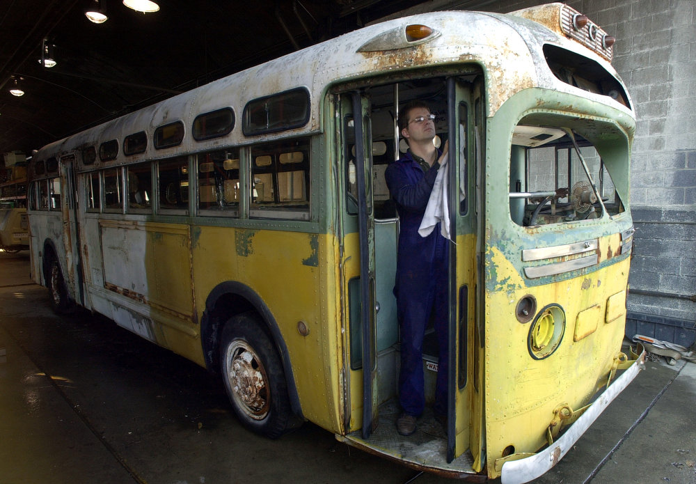 . Malcolm Collum, senior conservator, works on cleaning up the 1948 General Motors bus on which Rosa Parks refused to give up her seat more than 45 years ago, at the Henry Ford Museum & Greenfield Village in Dearborn, Mich., Thursday, Nov. 15, 2001. The museum took possession of the bus Thursday after acquiring it at auction for $492,000 in October.  (AP Photo/Paul Sancya)