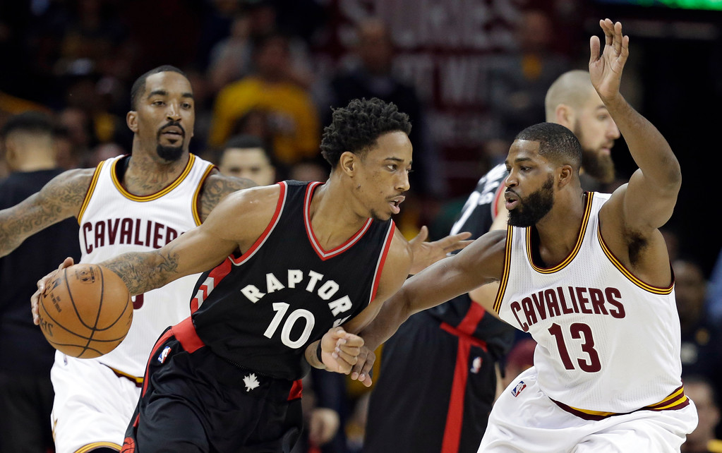 . Toronto Raptors\' DeMar DeRozan (10) drives past Cleveland Cavaliers\' Tristan Thompson (13) in the first half in Game 1 of a second-round NBA basketball playoff series, Monday, May 1, 2017, in Cleveland. The Cavaliers won 116-105. (AP Photo/Tony Dejak)