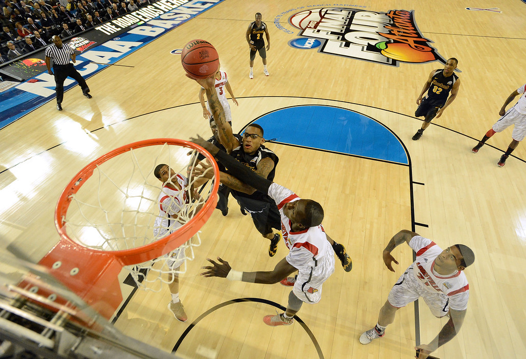 . ATLANTA, GA - APRIL 06:  Carl Hall #22 of the Wichita State Shockers attempts a shot in the first half against Gorgui Dieng #10 of the Louisville Cardinals during the 2013 NCAA Men\'s Final Four Semifinal at the Georgia Dome on April 6, 2013 in Atlanta, Georgia.  (Photo by Chris Steppig-Pool/Getty Images)
