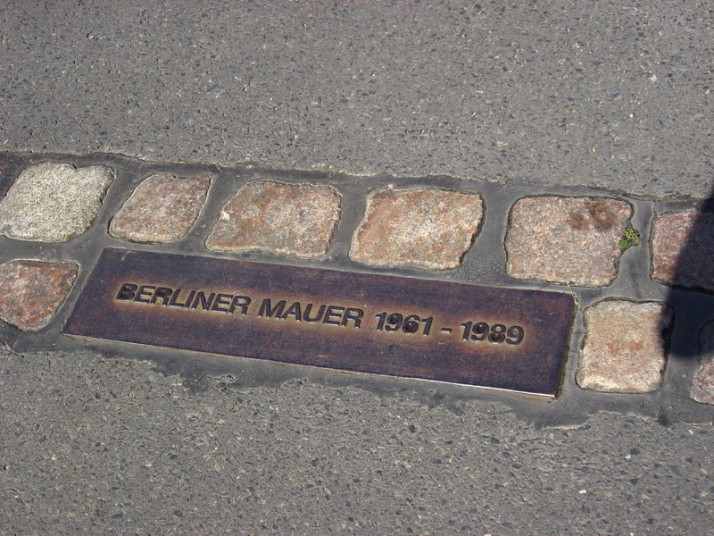 Cobblestone path showing where the Berlin Wall stood