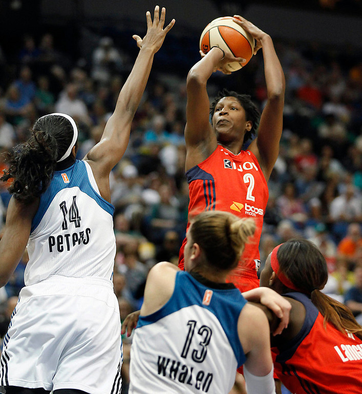 . Washington Mystics center Michelle Snow (2) takes a shot against Minnesota Lynx forward Devereaux Peters (14) in the first half. (AP Photo/Stacy Bengs)