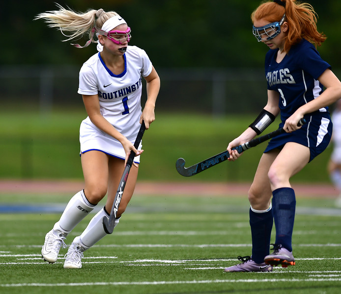 10/4/2018 Mike Orazzi   Staff Wethersfield's Lorien Touponse (3) and Southington's Anna Laone (1) during field hockey Thursday at Southington High School.