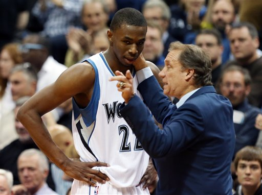 . Minnesota Timberwolves head coach Flip Saunders gives pointers to rookie Andrew Wiggins as he headed to the bench in the second half of an NBA basketball game, Thursday, Oct. 30, 2014, in Minneapolis. The Timberwolves won 97-91. (AP Photo/Jim Mone)