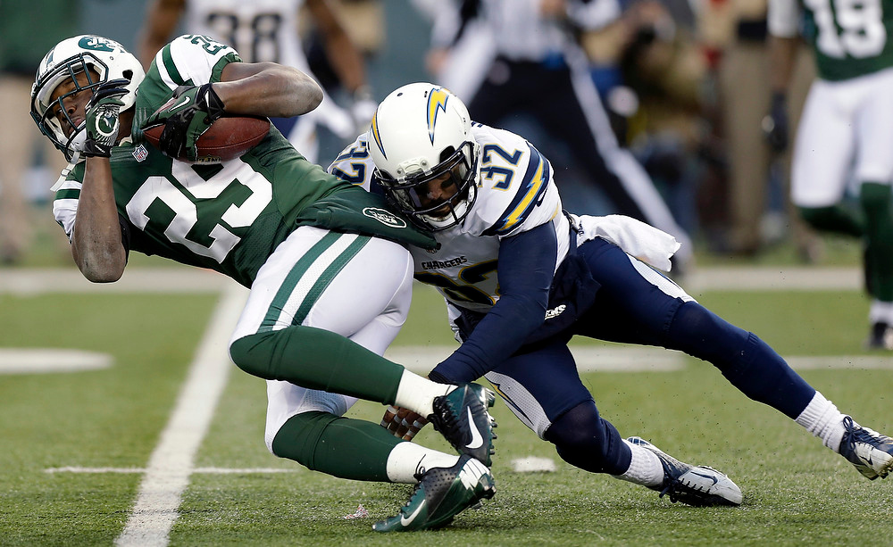 . New York Jets running back Bilal Powell (29) is tackled by San Diego Chargers free safety Eric Weddle (32) during the second half of an NFL football game on Sunday, Dec. 23, 2012, in East Rutherford, N.J. The Chargers won 27-17. (AP Photo/Kathy Willens)