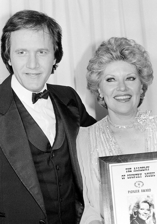 . Singer Patti Page, right, poses with Roger Miller, who presented her with the Academy of Country Music Pioneer Award, in May 1980.  (AP Photo)