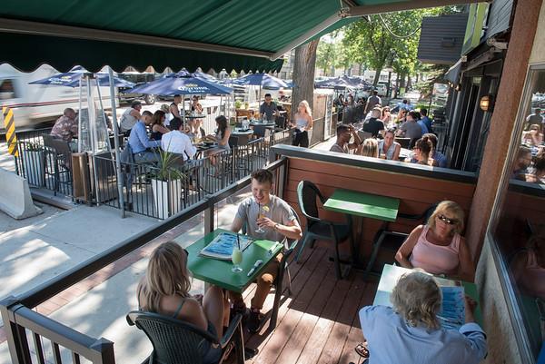 People enjoy the patio on Corydon Ave Friday June 10, 2016 (David Lipnowski for Metro News)