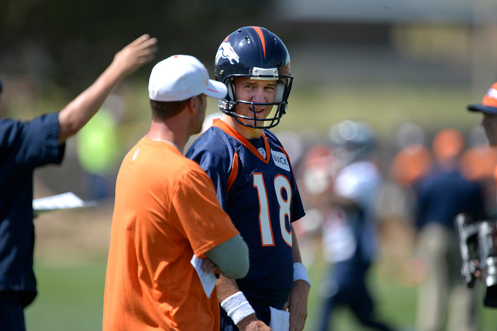 . Denver Broncos Peyton Manning (18) talks with offensive coordinator Adam Gase during OTAs June 10, 2014 at Dove Valley. (Photo by John Leyba/The Denver Post)