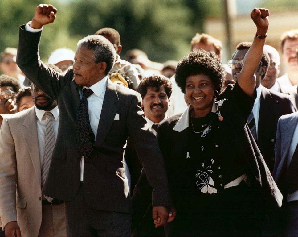 . Nelson Mandela and wife Winnie, walking hand in hand, raise clenched fists upon his release from Victor prison, Cape Town, Sunday, February 11, 1990.  The African National Congress leader had served over 27 years in detention. (AP Photo)