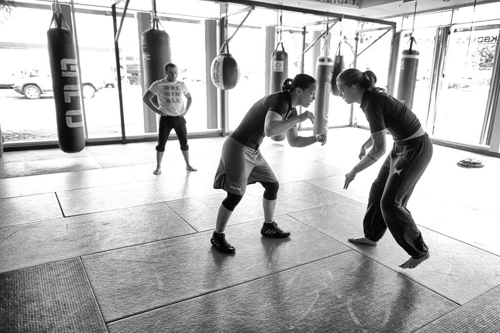 . Shayna Baszler and Jessamyn Duke wrestle as wrestling coach Martin Berberyan looks on. (Photo by Hans Gutknecht/Los Angeles Daily News)