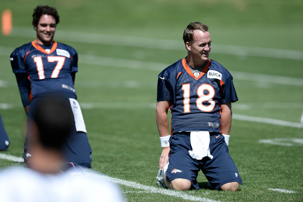 . Peyton Manning (18) QB of the Denver Broncos stretches during OTAs June 3, 2013 at Dove Valley. (Photo By John Leyba/The Denver Post)